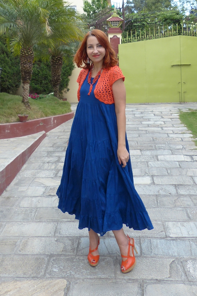 Blue maxi dress worn with orange shrug