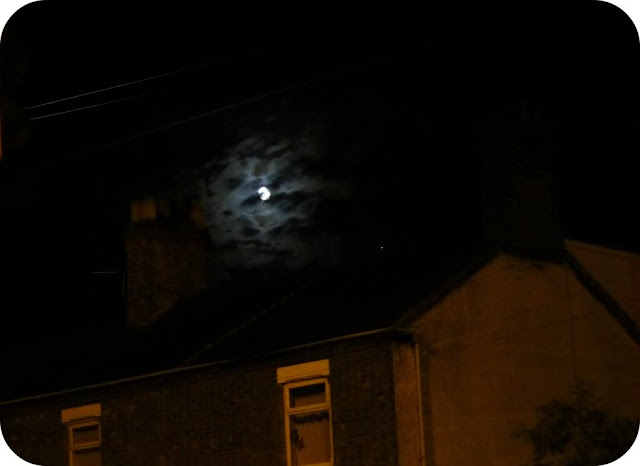 Moon over the houses