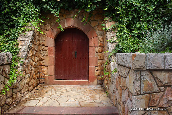 A wooden door in a dry stone wall