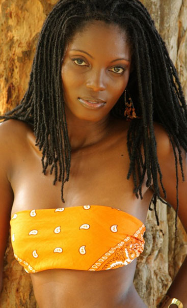 Nubian black American woman most beautiful sexy dark skin dreadlocs.