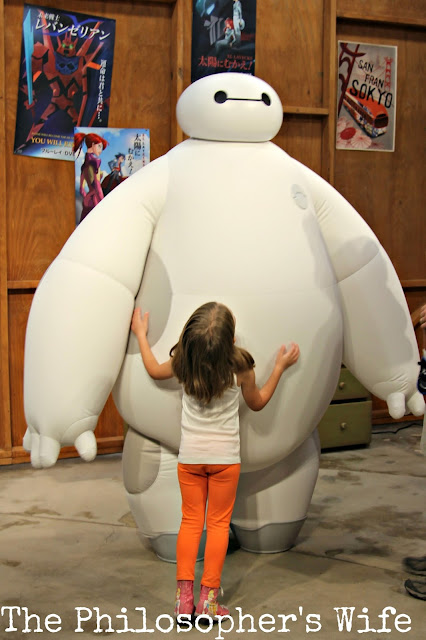 A girl meets Baymax, from Big Hero 6, in a character meet and greet at EPCOT.