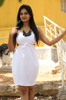 Neha Deshpandey in Lovely White BVackless Dress at Anu Vamsi Katha Opening