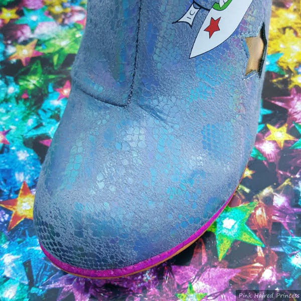 rounded toe of blue snakeskin boot with purple trim
