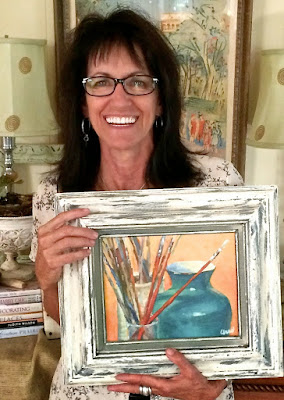 Denise Cerro with her painting