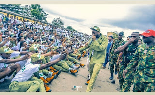 Photos of Davido addressing his fellow corps members as they sit on the floor at Lagos NYSC Camp