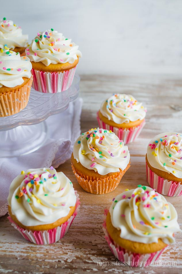 A easy and sweet recipe for Vanilla Cupcakes with Vanilla Butter Cream Frosting!  |  mynameissnickerdoodle.com
