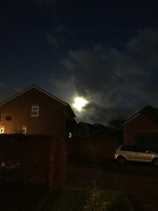bright-light-in-dark-sky-super-moon-over-house-in-cardiff