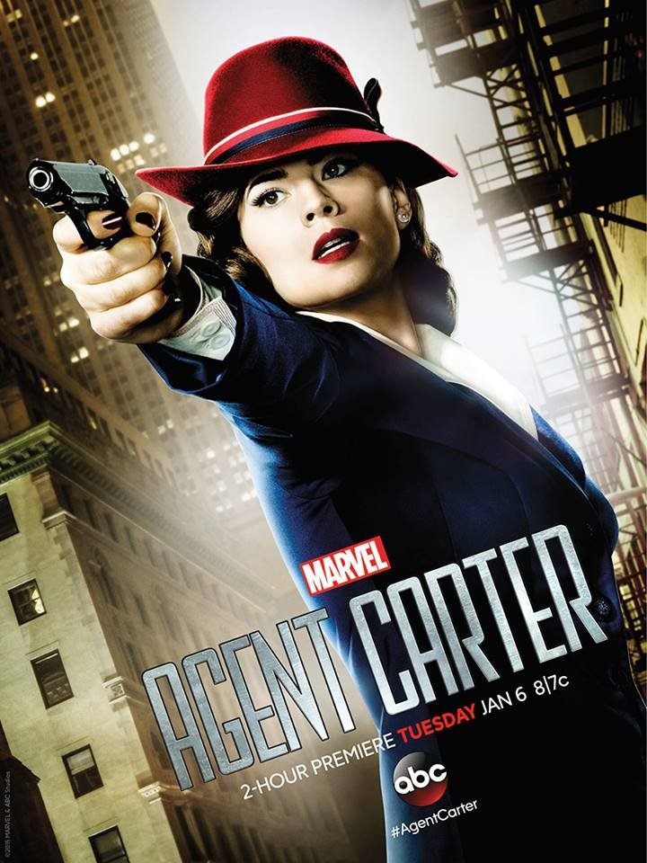 Season 1 'Agent Carter' poster: Dutch-angle shot of Carter on New York City street in her signature red hat pointing a gun with golden light around her