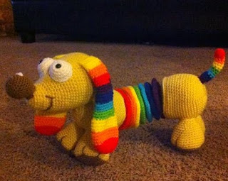 http://www.craftsy.com/pattern/crocheting/toy/rainbow-slinky-dog/96142