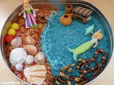 A beach and underwater themed sensory tub for children