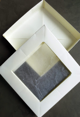 handmade paper box with wax paper window