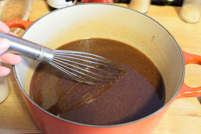 All the ingredients in the pot for the bbq sauce being whisked together.
