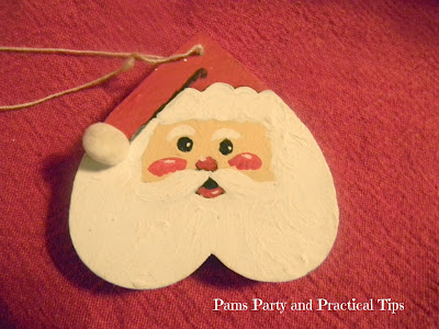 Santa painted on a wooden heart