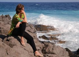 A woman thinking near a seashore.