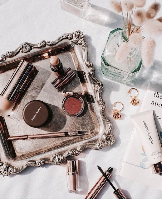 beauty flat lay with nude by nature products on a silver tray