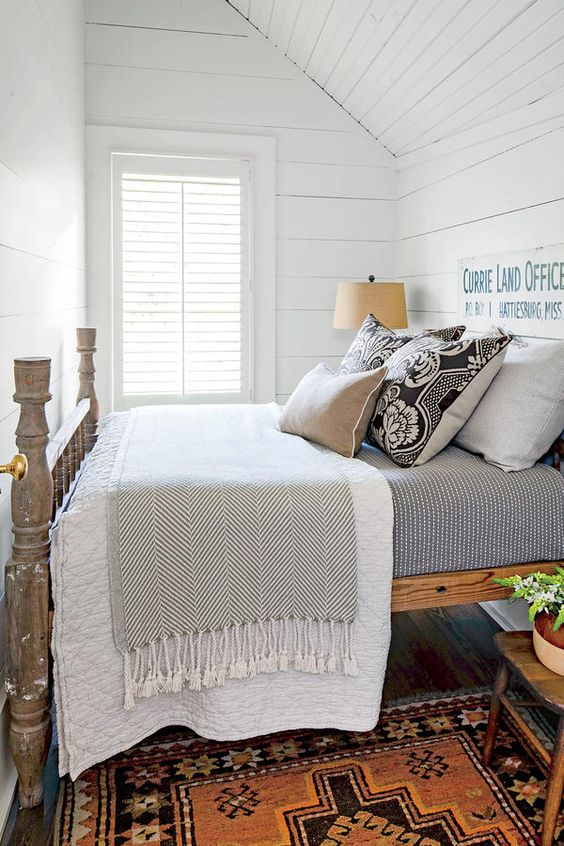 Charming farmhouse bedroom with bold colorful rug and shiplap walls - found on Hello Lovely Studio