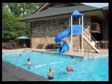 Outdoor pool and slide Greystone Lodge