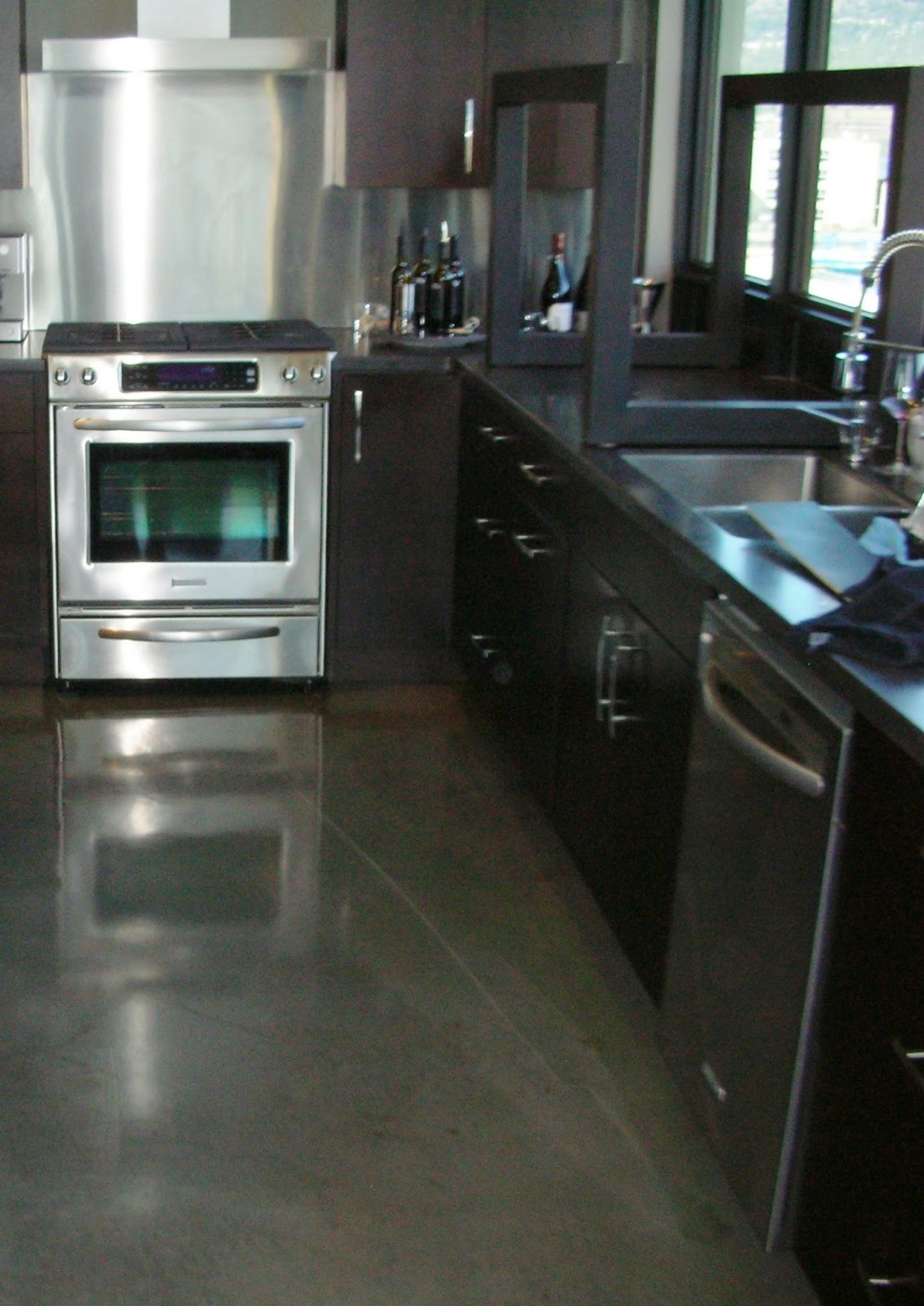 finishing basement concrete floors concrete kitchen floor Help remedy Lackluster Concrete Floors by Finishing them Naturally inexpensive starting at 2 50 3 50 sq ft Contact MODE CONCRETE in Kelowna