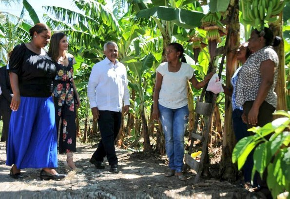 Queen Letizia of Spain visited organic banana cooperative in Tramojos de Azua town. Queen Letizia wore Uterque V-neck floral jumpsuit and Magrit pumps