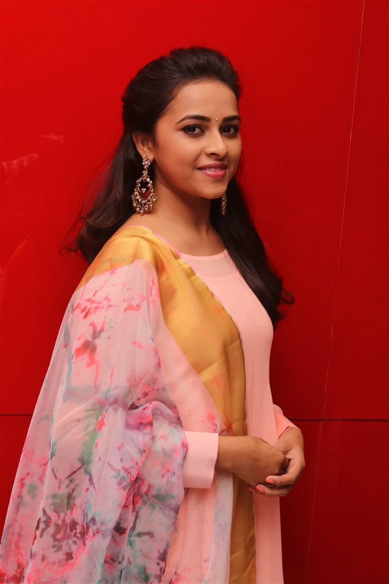 Actress Sri Divya Stills In Pink Dress At Movie Audio Launch