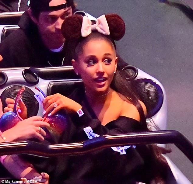 Ariana Grande shows off her engagement ring while at Disneyland with beau, Pete Davidson