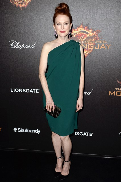 Julianne Moore in a one-shoulder Lanvin dress and satin pumps with Chopard earrings and a Tod's clutch at Cannes 2014