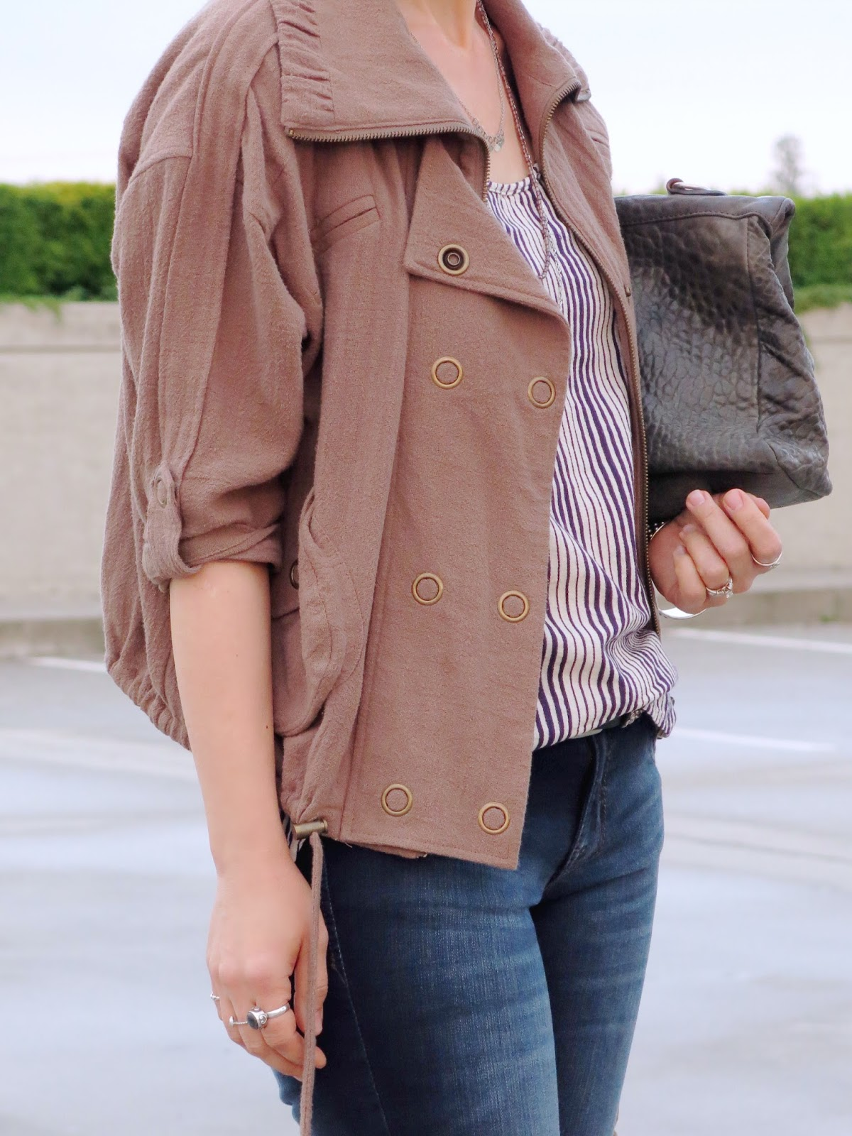 styling skinny jeans with a striped tank and khaki bomber jacket