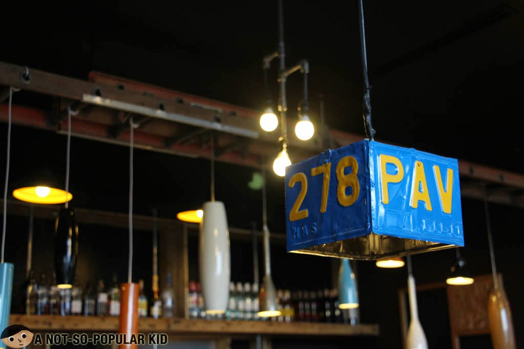 Interesting designs in Backyard Restaurant - plate number for the lights