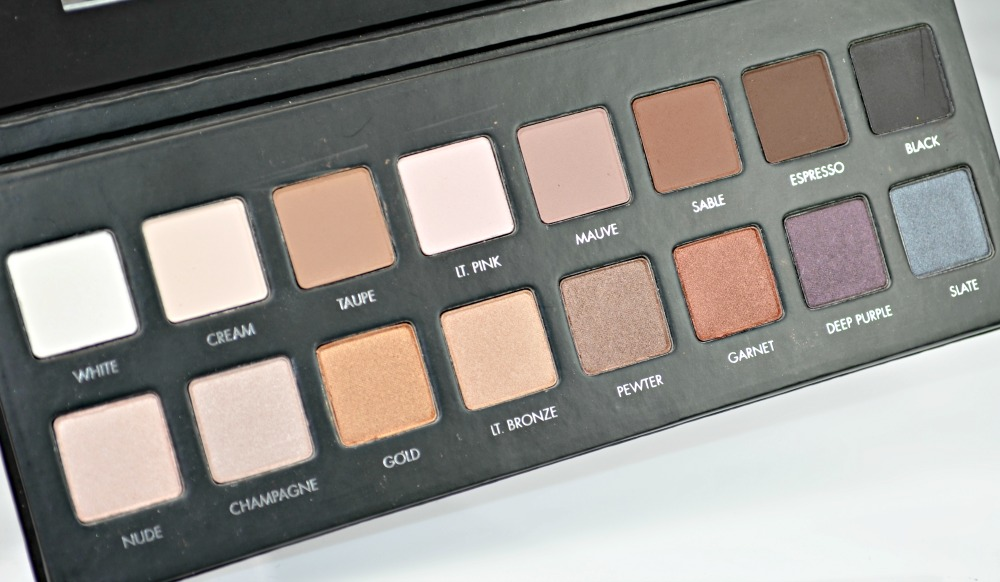 Image of the eyeshadow palette open with the fourteen shadows on show