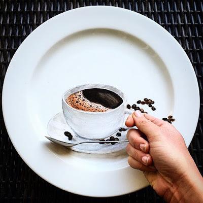 Pintura de una taza de café en un plato de comida