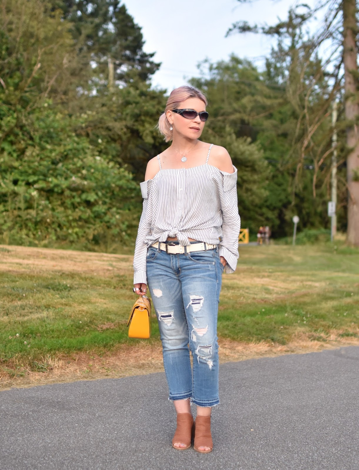 Monika Faulkner personal style inspiration - an off-the-shoulder striped shirt with distressed cropped jeans and cut-out booties