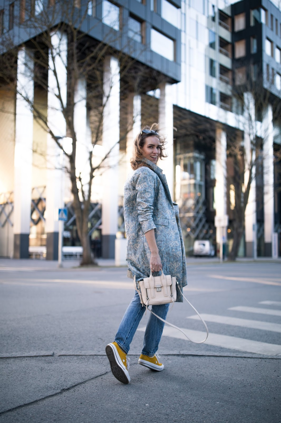 blue coat jeans sneakers outfit