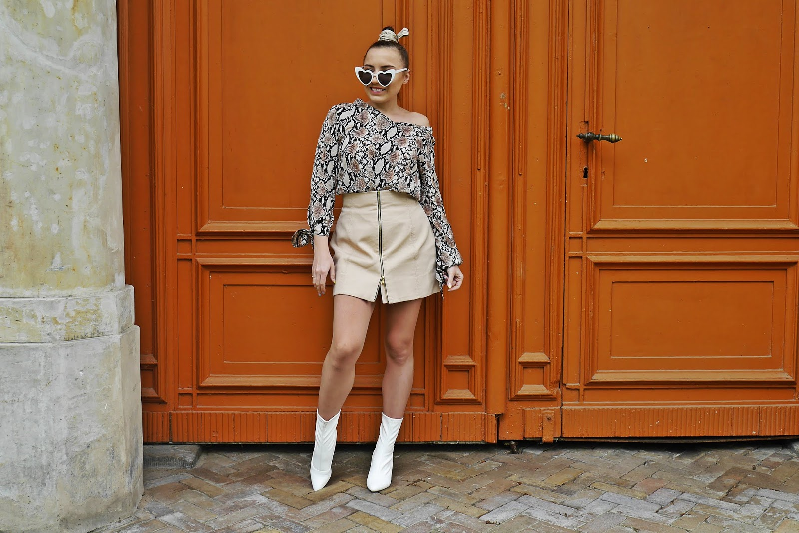 white socks shoes boots beige skirt leo print top outfit look sunglasses karyn fashion blogger