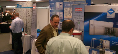 engineer speaking with customer about process equipment at showcase exhibit