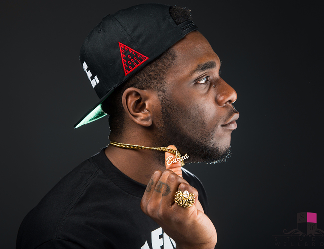 Burna Boy declared wanted as suspects claim he paid them to rob artiste