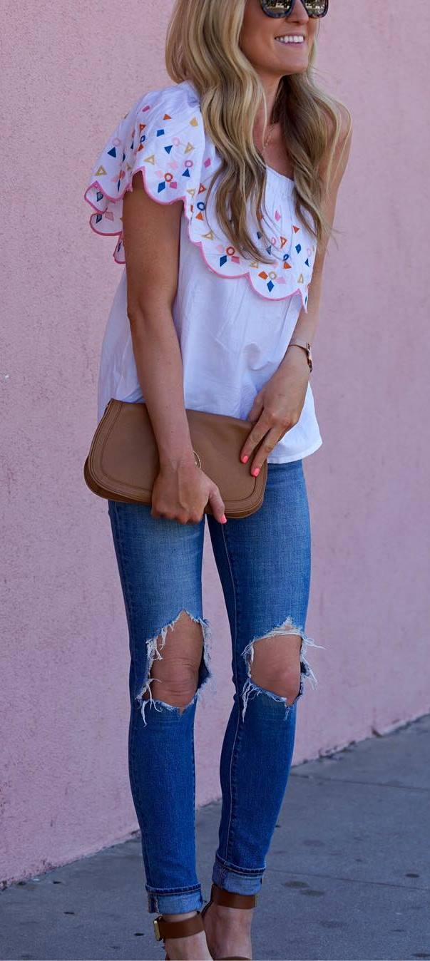 casual outfit idea top + ripped jeans + bag