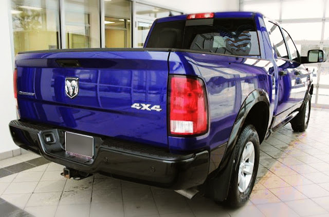 american-flag-and-eagle-decal-on-rear-window-blue-ram-1500-4x4-with-emblem-on-tailgate