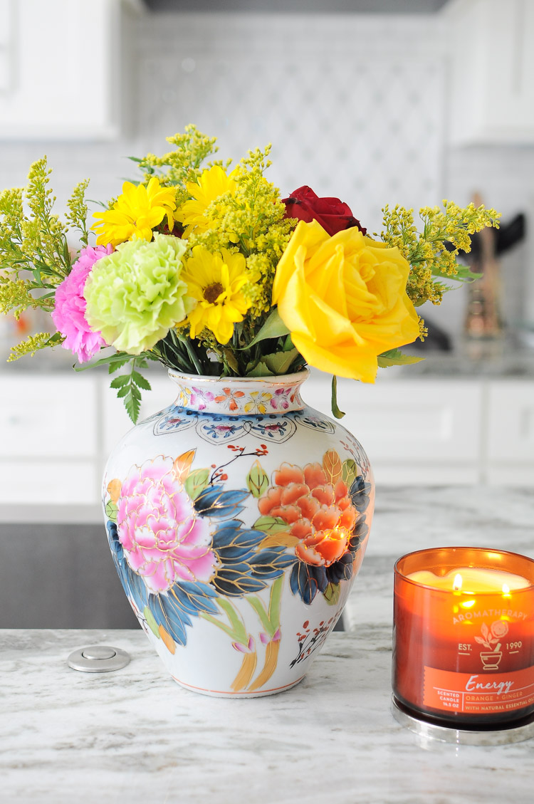 A simple floral arrangement on a kitchen island can add style and color to a kitchen.