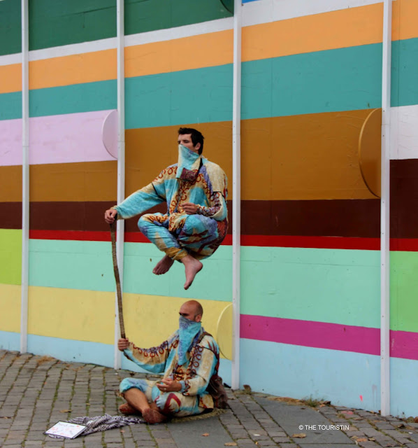 Street Artists, floating in the air