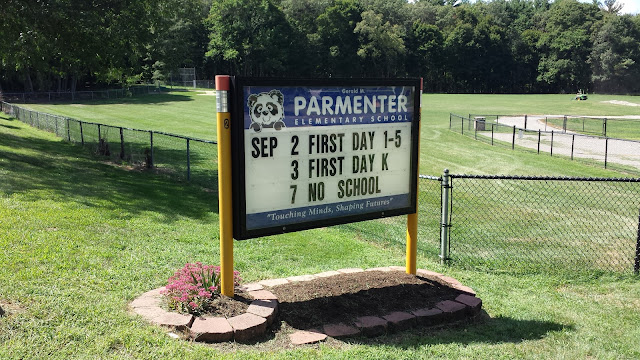 Parmenter sign with school opening schedule