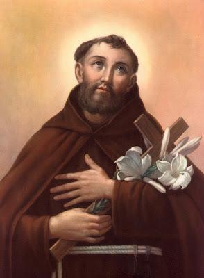En la imagen San Fidel sosteniendo en los brazos la Cruz y los lirios blancos, simbolo de la pureza.