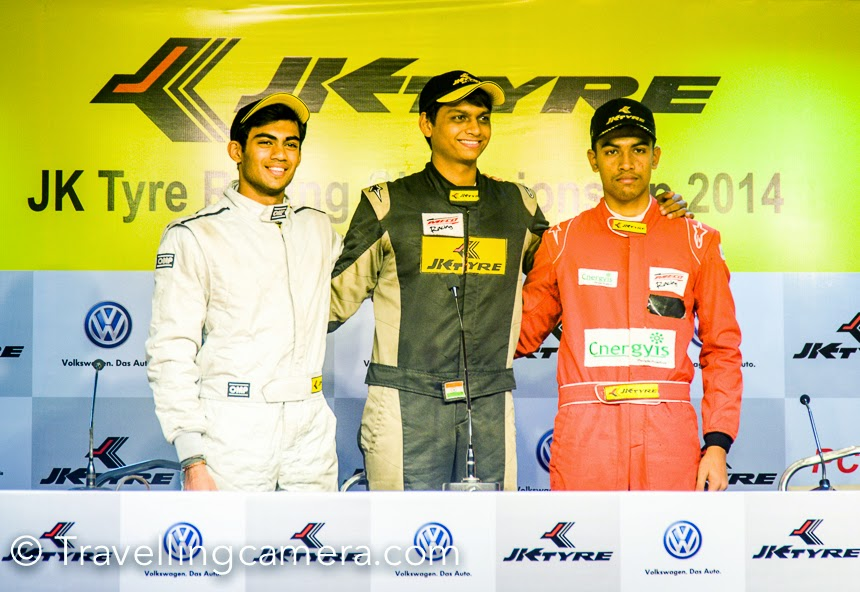 This weekend Photo Journey team was at Budhh International Circuit to experience Motorsports at JK Tyre Racing Championship. The 3rd round races happened on 9th Nov at India's Budhh International Circuit in Great Noida. This Photo Journey shares some action filled moments from the BIC tracks full of roaring supermachines.Event was planned to start at 10:30 and we were there at around 10am. It took some time to locate Paddlock club of Budhh International Circuit. Finally we reached the right place and met other friends at JK Tyre lounge. Things were just warming up at that moment. The pit was just below the lounge and this place had perfect view to the place from where race starts.Here is the view of Grand Stand from Paddlock area where all the supermachines were gearing up for real action.JK Tyre has always been closely associated with the world of sports. Almost three decades back the company laid down a long term and sustained approach to promote Motorsport. Participating in this form of the sport has helped the company in continuously updating its products to meet the challenges of gruelling Indian conditions. The sport at that time in India was perceived for elite but JK Tyre took upon itself to package and redesign the sport to suit the masses. The company not only made the sport affordable but also equivalent to International operating standards. JK Tyre's foray into Motorsport was a well thought out strategic decision to not only use and develop this virgin branding platform but also to realize the dreams of making India a force in the field of motor sport.In 2011, the company acquired the Formula BMW Series and rechristened it as the JK Racing Asia Series (JKRAS). With this acquisition, JK Tyre created history in Indian Motorsport by becoming the first Indian company to acquire an FIA accredited series. The series has to its credit of producing as many as six of the current Formula One drivers, including reigning two- time champion Sebastian Vettel. This series was then converted to JK Racing India Series from 2013 to give more impetus to Indian talent in motorsports. JK Tyre now stands closer to achieving its mission of bringing world-class motorsport to the Indian masses.The Racing and Karting programme by JK Tyre has been the breeding ground for the country's motorsport talents like Narain Karthikeyan, Armaan Ebrahim, Karun Chandhok, Aditya Patel and other new emerging talents.Vibha enjoyed the races from comfortable lounge, while I was having more fun around the tracks and of course, with my Travellingcamera.It was great to be around Motorsport enthusiasts. And after a long time, I met lot of friends from Himalayan & Northern Motorsports.We were really excited to be around these roaring machines at Budhh International Circuit. One of the friends had pass for service lane, so we could drive in the service lane to catch these fast moving machines at different parts of the track.Grand Stand of Budhh International Circuit was full of Motorsports enthusiasts.During lunch at JK Tyre lounge, there were some amazing performances organized. These girls were playing Indian songs and their performances were amazing.Safety Car waiting on the track to take a round of the track before rides hit the race ground.The newly introduced JK Super Bikes Cup received a resounding response with the grandstand getting choc-a-bloc to watch riders perform stunts and tricks besides racing the track.Delhi boy Kulwant Singh Monty got the best finish clocking 16:55.583. Gurvinder Singh and Bhupinder Singh followed Kulwant into the podium by finishing 2nd and 3rd showcasing their skills in 1000CC engine bikes.JK Racing India Series FB02 (Race 3): 1. Vishnu Prasad (Chennai) 21:51.177, 2. Akhil Rabindra (Bangalore) 21:58.631; 3. Ananth Shanmugam (Bangalore) 21:59.815; 4. Nayan Chatterjee (Mumbai) 22.09.303; 5. Sandeep Kumar (Chennai) 22:10.497Formula LGB 4 (Race 3): 1. Diljith TS (Dark Don) 20:02.245, 2. Vishnu Prasad (Meco Racing) 20:02.574, 3. Raghul Rangaswamy (Meco Racing) 20:02.912, 4. Ameya Bafna (Rayo Racing) 20:05.763, 5. Chittesh S Mandody (Meco Racing) 20:06.172.Racing India Series FB02 (Race 2): 1. Vishnu Prasad (Chennai) 22:00.295, 2. Rahil Noorani (Mumbai) 22:14.946, 3. Akhil Rabindra (Bangalore) 22:18.461; 4. Sandeep Kumar (Chennai) 22:19.893; 5. Ananth Shanmugam (Bangalore) 22:20.469.VW Polo R Cup (Race-2): 1. Dylan Pereira (Poland) 22:11.363, 2. Karminder Pal Singh (New Delhi) 22:14.271, 3. Karthik Tharani (Chennai) 22:16.562, 4. Gosia Rdest (Poland) 22:17.416, 5. Bonnie Thomas 22:19.586 (Thodupuzha)JK Super Bikes Cup: Kulwant Singh Monty- 16:55.583, Gurvinder Singh- 17:01.653, Bhupinder Singh- 17:03.102, Manmeet Singh- 17:55.816, Aashir Agarwal:- 18:16.258.
