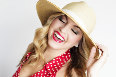 beautiful women laughing in a hat