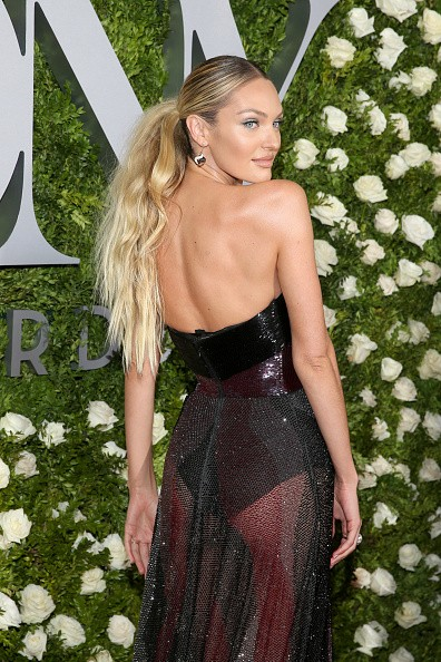 Candice Swanepoel flaunts her model legs in see-through gown at Tony Awards