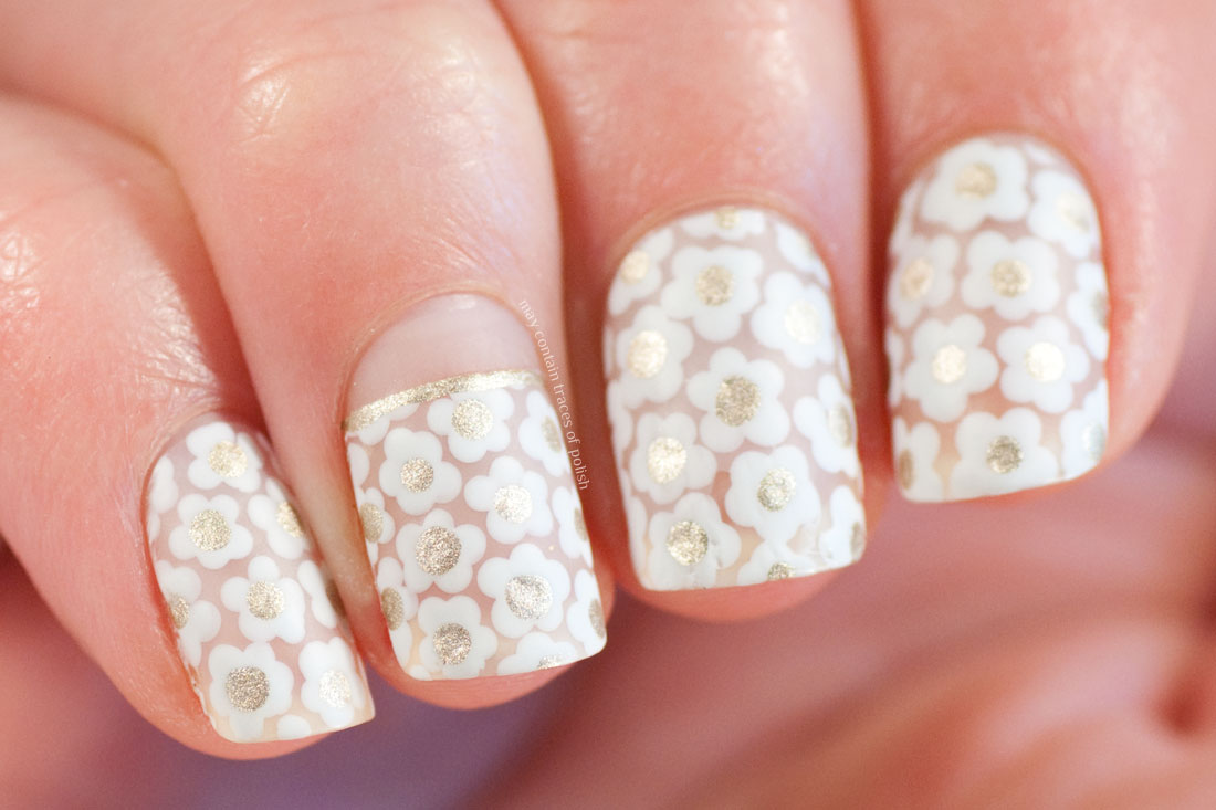 White Floral Negative Space Nail Art - May contain traces of polish