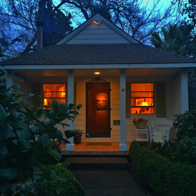 small b&b cottage in Calistoga with lights glowing inside