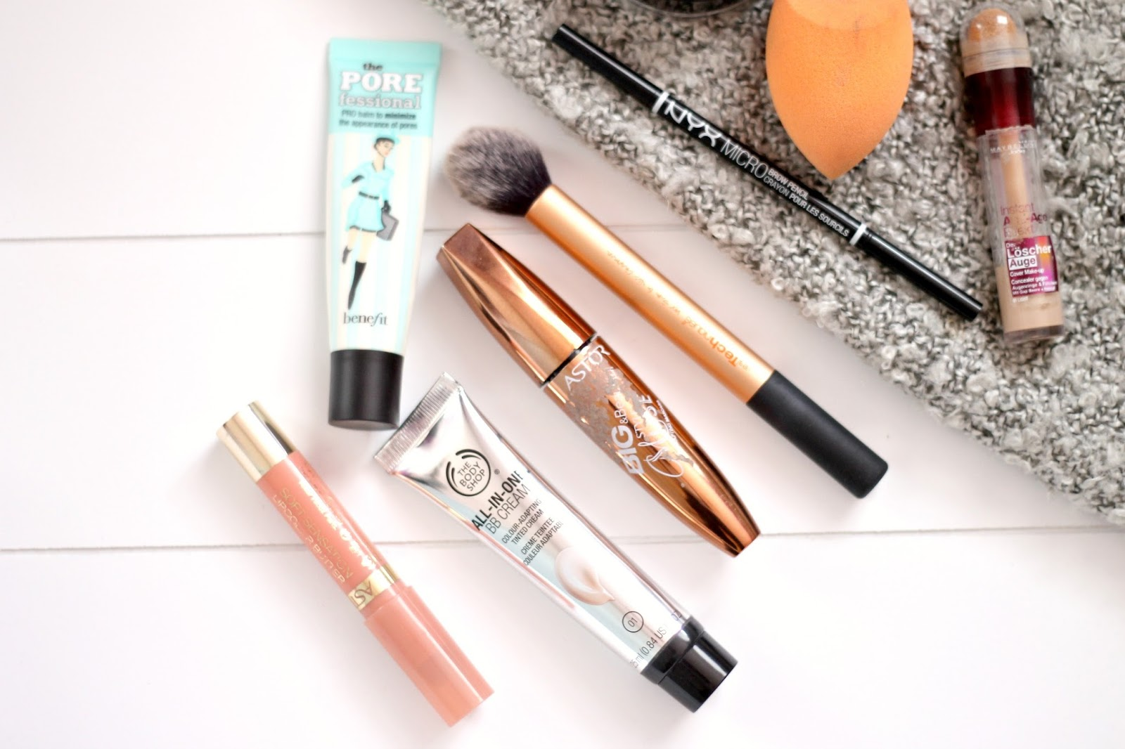 flatlay, close up, porefessional primer, makeup brush, bb cream,