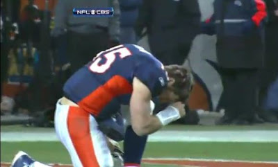 Tim Tebow Tebowing after Denver Broncos win