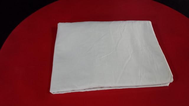Passo a passo para dobrar um lençol de elástico