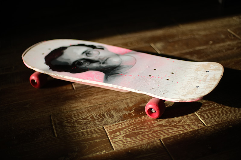 A skateboard artwork of Keith Haring created by artist James Straffon